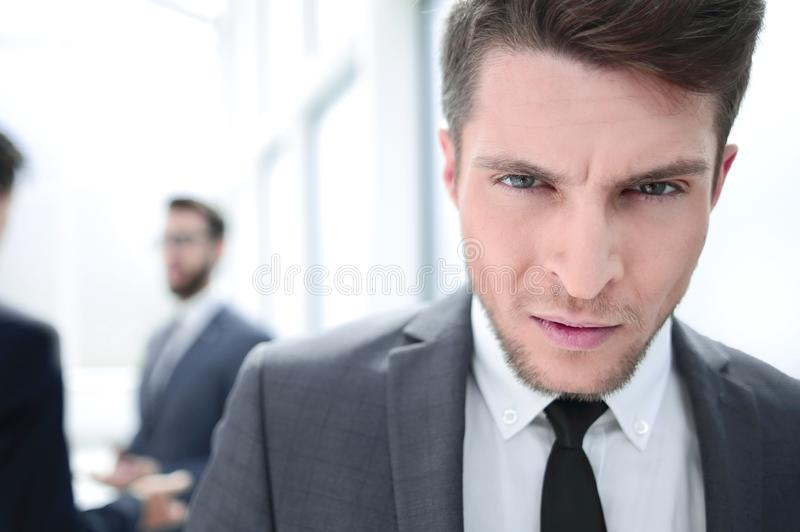 Close up.portrait of a serious young businessman royalty free stock image