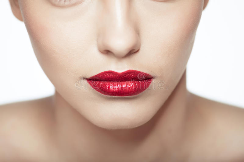 Close-up portrait of caucasian young model. With glamour red lips make-up. Perfect clean skin stock photography
