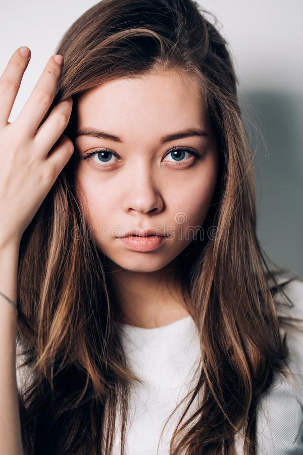Close-up portrait of woman. Beautiful girl looking at the camera royalty free stock photography