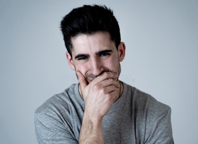 Human expressions and emotions. Portrait of young attractive sad and depressed man. Close up portrait of young man looking sad and stressed crying and feeling royalty free stock photos
