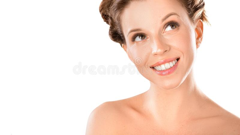Close up portrait of a smiley woman. Healthy shining skin, teeth health and natural beauty concept. Isolated on white. Background royalty free stock photo
