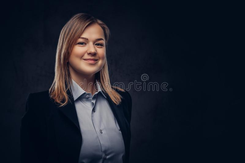 Portrait of a smiling blonde businesswoman formal dressed. Isolated on dark textured background. Close-up portrait of a smiling blonde businesswoman formal stock photos