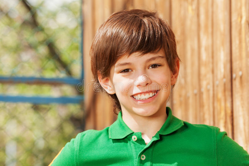 Close-up portrait of smiling dark-haired boy royalty free stock photo