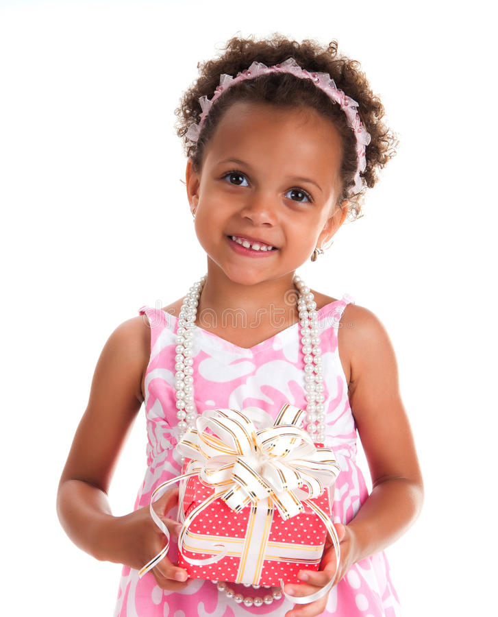Close-up portrait smiling girl with curly hair and gift on a white background.  stock images