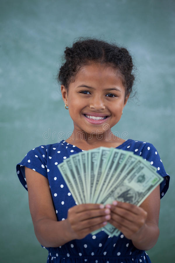 Close up portrait of smiling girl showing paper currency stock image