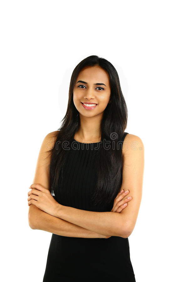 Close up portrait of a smiling Indian business woman. With arms crossed isolated on white royalty free stock photography