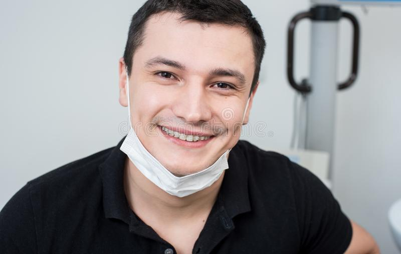 Close-up portrait of smiling male dentist at the dental office stock photography