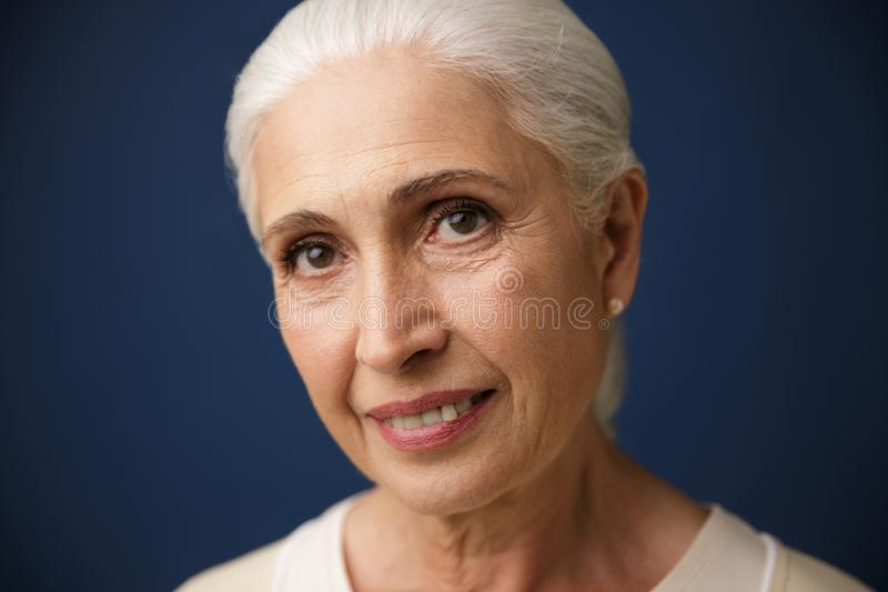 Close-up portrait of smiling mature caucasian woman, looking at stock photos
