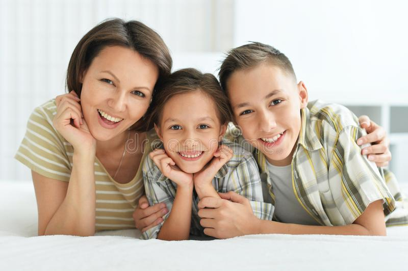 Close up portrait of smiling mother with children royalty free stock images