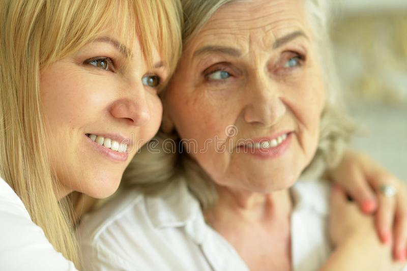 Close up portrait of smiling mother and daughter stock photo