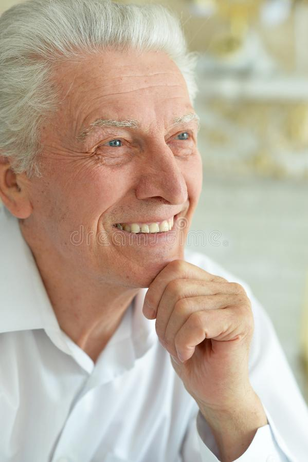 Close up portrait of smiling senior man stock photos