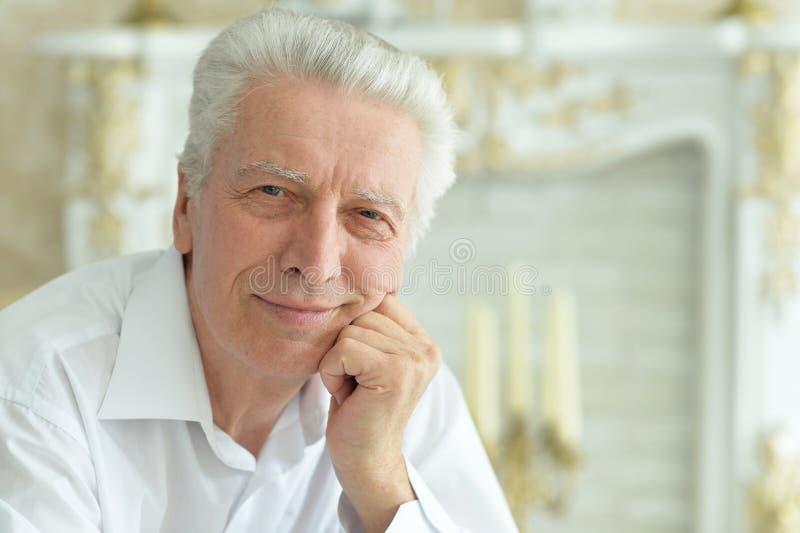 Close up portrait of smiling senior man stock photography