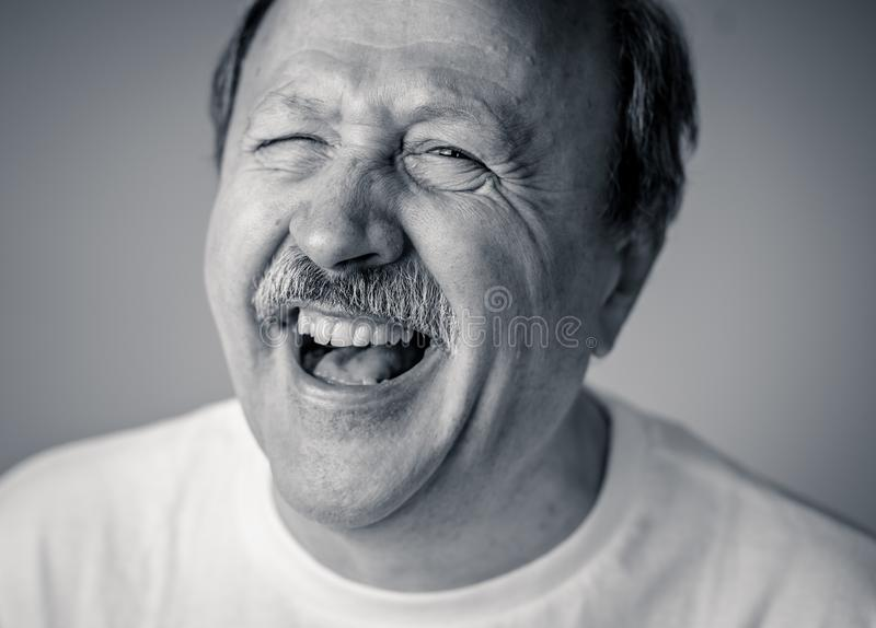Close up portrait of smiling senior man with happy face looking at the camera stock photography
