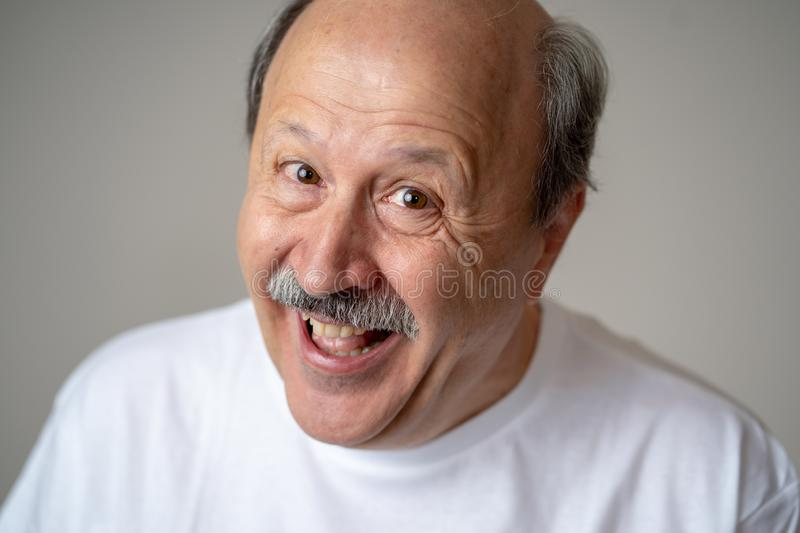 Close up portrait of smiling senior man with happy face looking at the camera stock photo