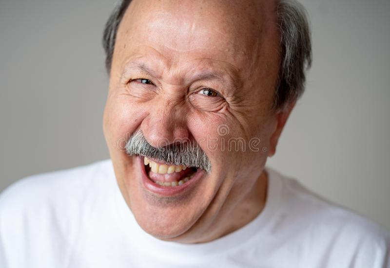 Close up portrait of smiling senior man with happy face looking at the camera royalty free stock photo