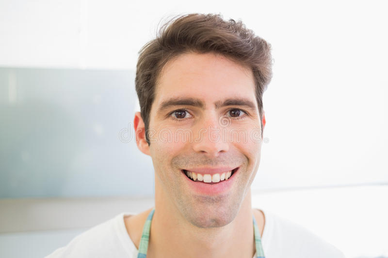 Close up portrait of a smiling young man royalty free stock photo