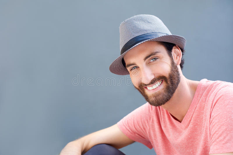 Close up portrait of a smiling young man with hat royalty free stock photography