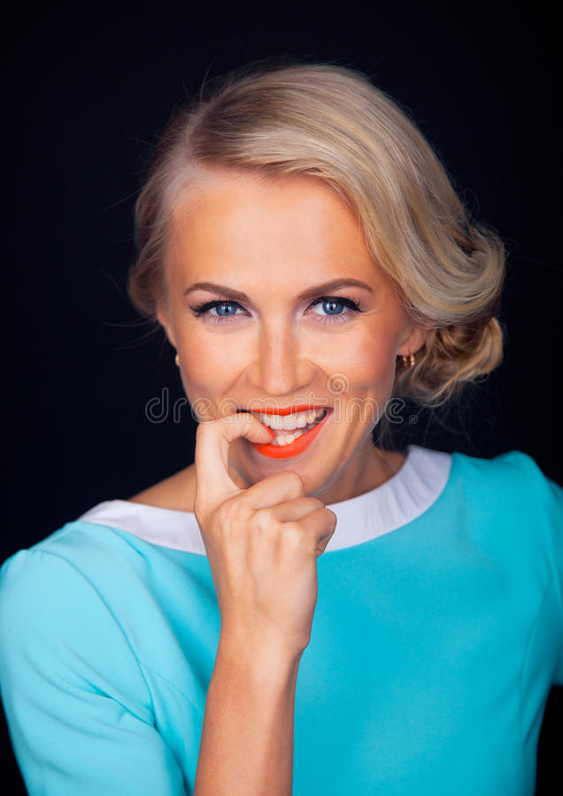Close-up portrait of smiling young woman with stock photo
