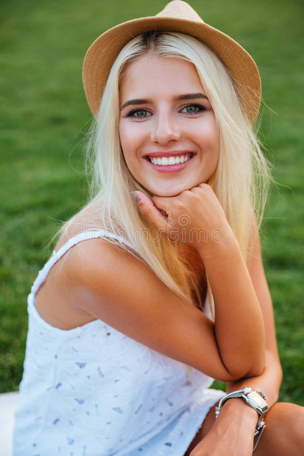 Close up portrait of a smiling young woman in hat stock photo