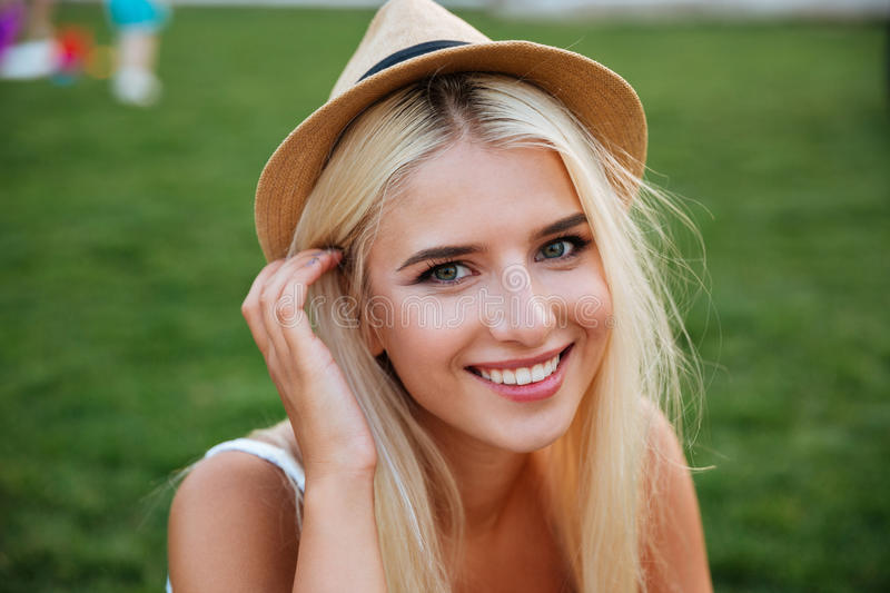 Close up portrait of a smiling young woman in hat royalty free stock photo