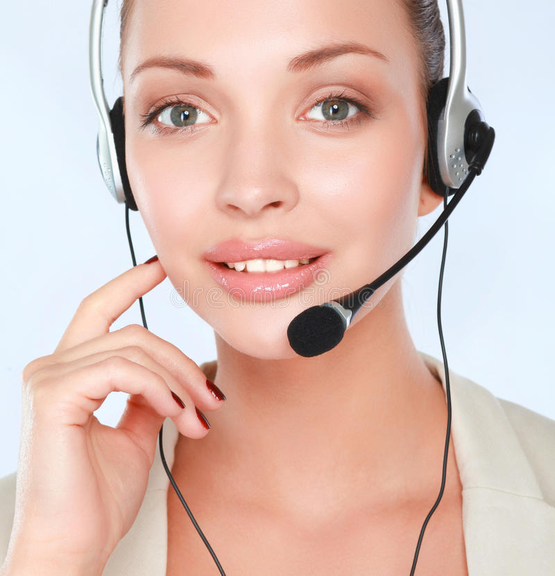 Close-up portrait of smiling young woman with headset isolated on white background royalty free stock photo