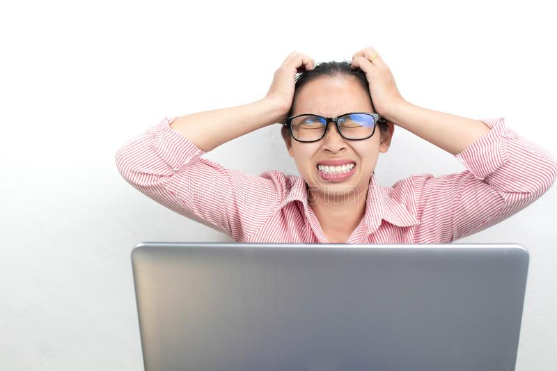 Close up portrait of stressed Asian woman, wearing glasses, looking tablet with seriously face and have headach symtom, sitting stock photos