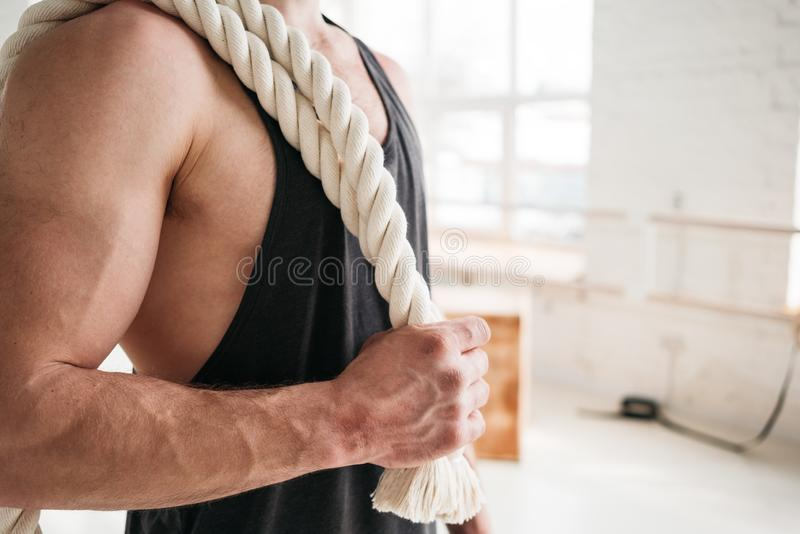 Close up portrait strong fit man with ropes in cross gym royalty free stock photography
