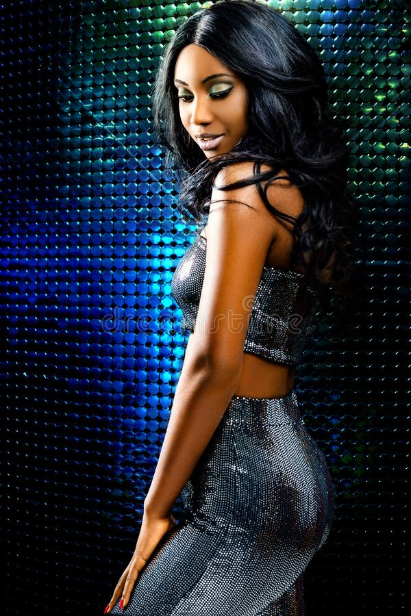 Attractive african woman against disco background royalty free stock photography