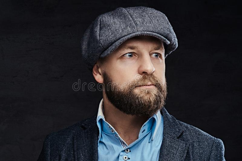 Close-up portrait of a stylish old-fashioned man wearing a beret and jacket, isolated on white background stock images