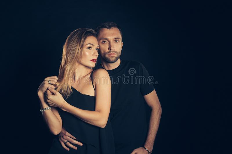 Portrait of stylish young couple, pretty woman and handsome man royalty free stock images