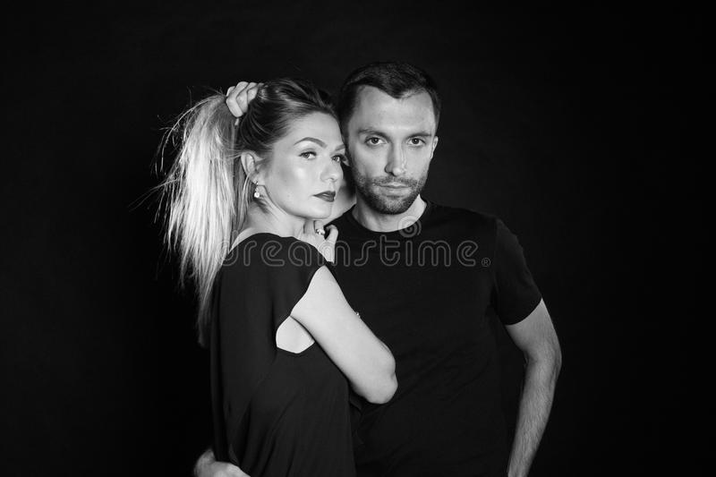 Portrait of stylish young couple, pretty woman and handsome man stock photos