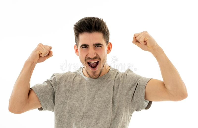 Close up portrait of surprised and happy man celebrating victory and wining lottery stock photo