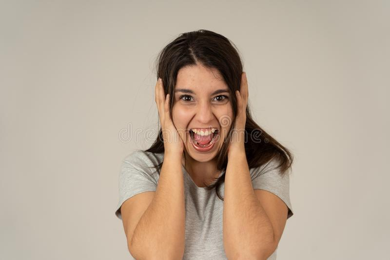 Close up portrait of surprised and happy woman celebrating winning lottery or victory stock image