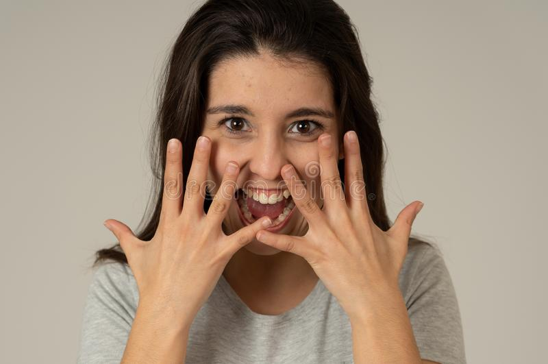 Close up portrait of surprised and happy woman celebrating winning lottery or victory royalty free stock photography