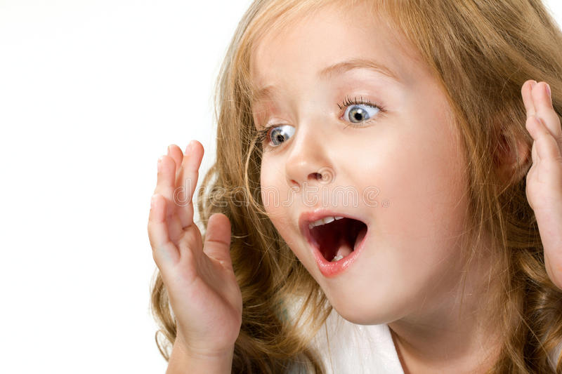 Close-up portrait of a surprised little girl royalty free stock image