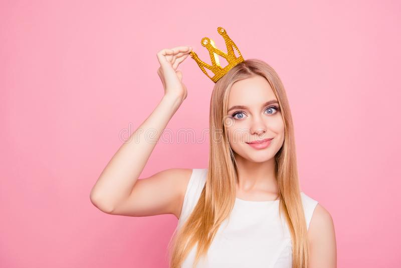 Close up portrait of sweet lovely attractive chic classy luxurious stunning gorgeous dreamy delightful excited cheerful queen. Of beauty putting crown on head stock photography
