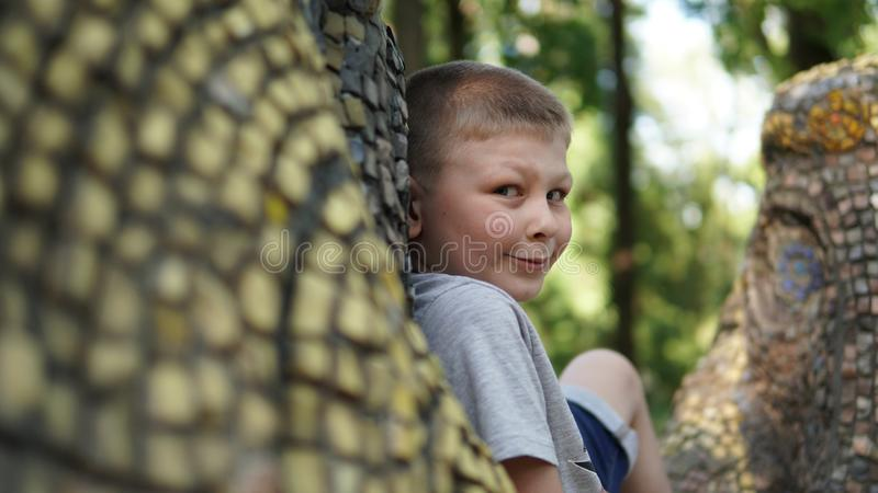 Close up portrait of teen boy. Funny cute teenager looking at camera. Close up portrait of caucasian teen boy. Funny cute teenager in summer park at day. Child royalty free stock photography