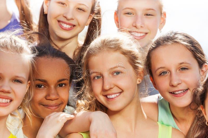 Close-up portrait of teenagers diversity in hug stock photos