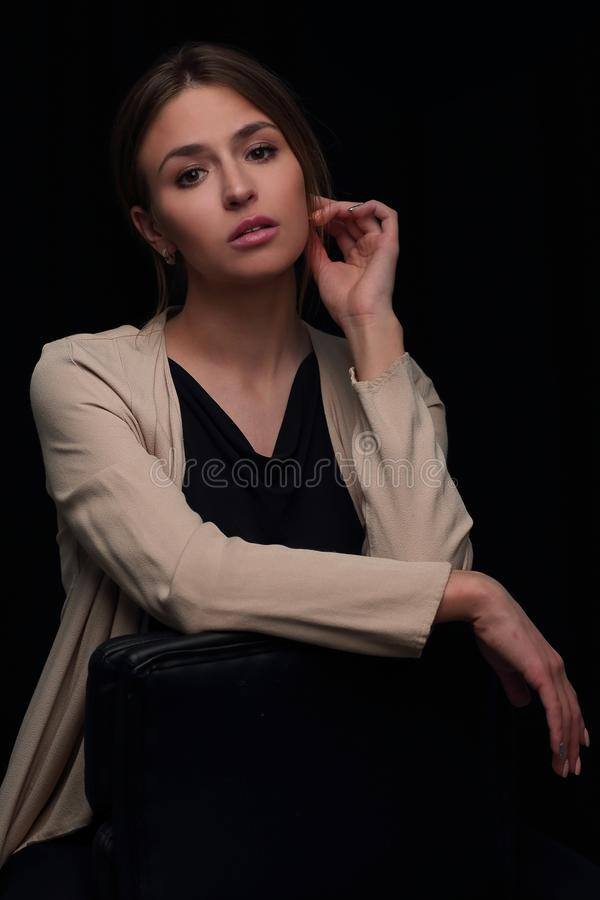 Close up.portrait of a thoughtful modern girl . isolated on black stock images