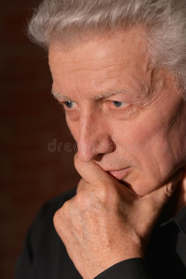 Close up portrait of thoughtful senior man stock photo