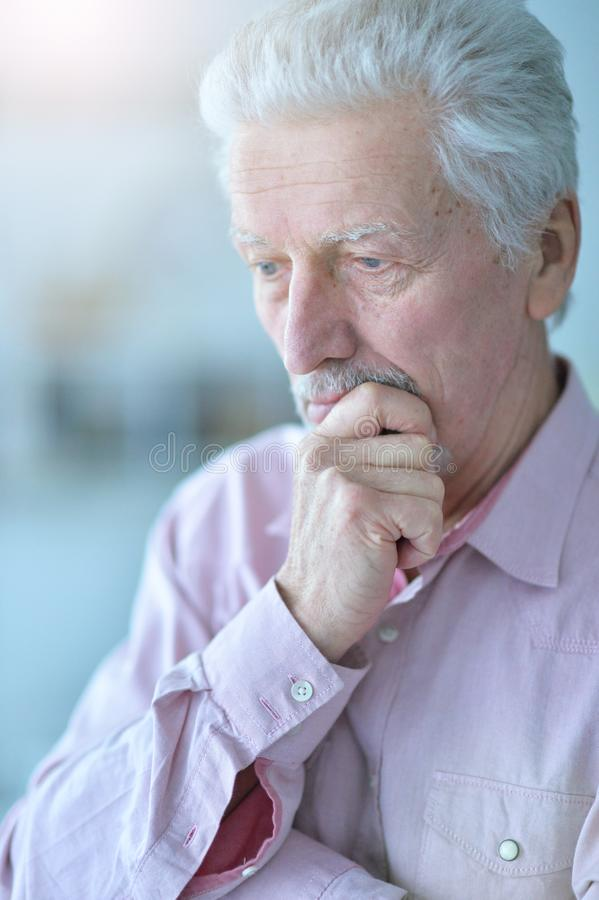 Close up portrait of thoughtful senior man royalty free stock photography