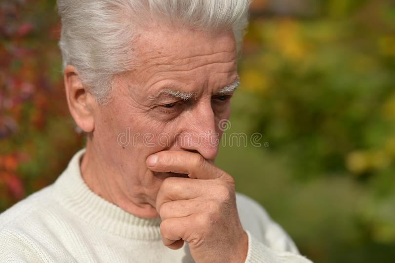 Close up portrait of thoughtful senior man outdoors royalty free stock photo