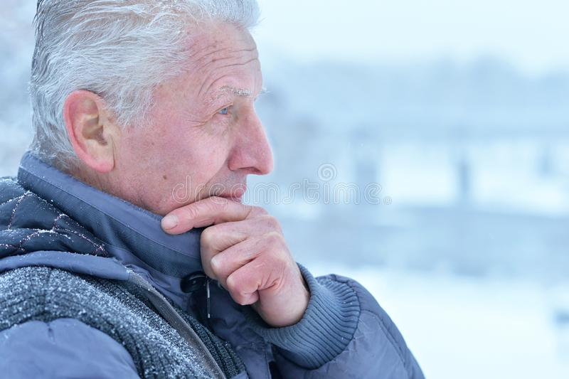 Close up portrait of thoughtful senior man stock images