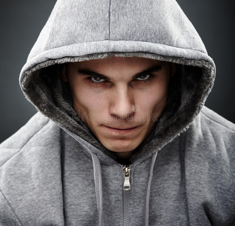 Close-up portrait of threatening thug stock image