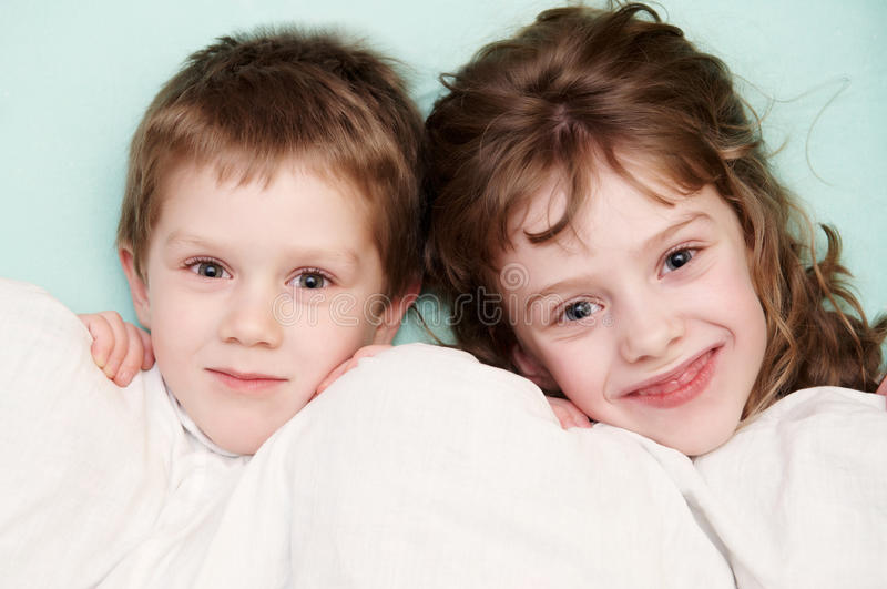 Download Close-up Portrait Of Two Children In Bed Stock Photo - Image: 21771330