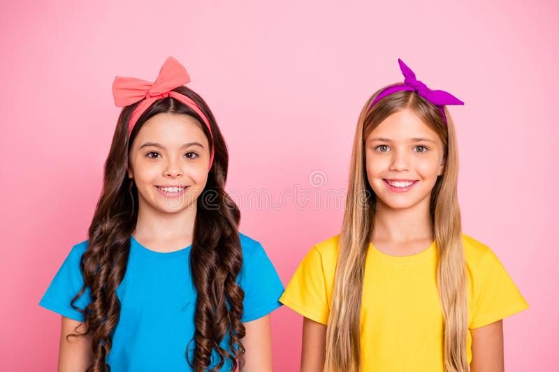 Close-up portrait of two nice-looking well-groomed attractive charming cute lovely cheerful cheery content pre-teen. Close-up portrait of two nice-looking well royalty free stock photo