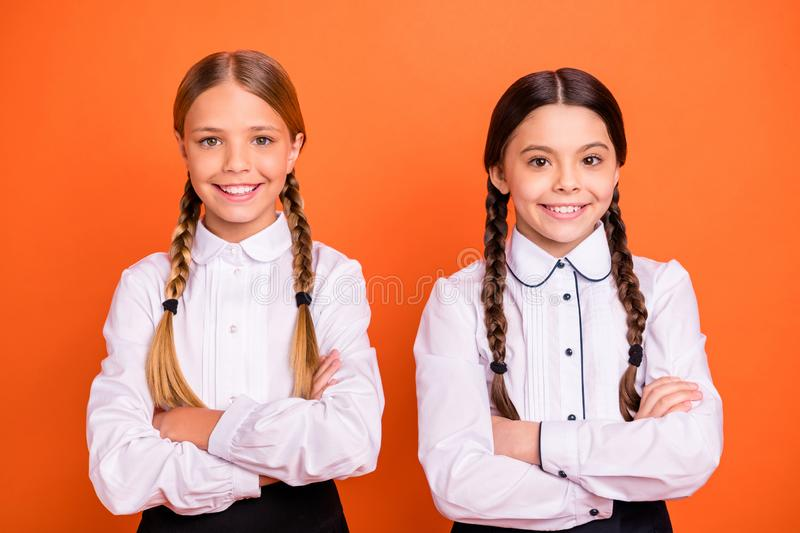 Close-up portrait of two person nice-looking attractive winsome charming cute lovely cheerful cheery girls folded arms. Close-up portrait of two person nice royalty free stock images