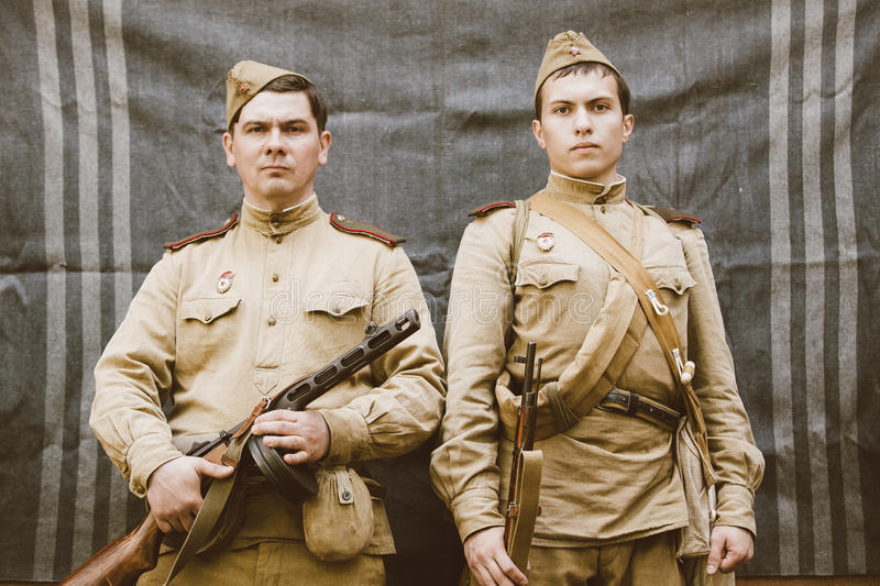 Close up portrait of two unidentified re-enactors dressed as Russian Soviet Infantry Soldiers Of World War II. Gomel, Belarus - May 9, 2015: Close up portrait of stock images