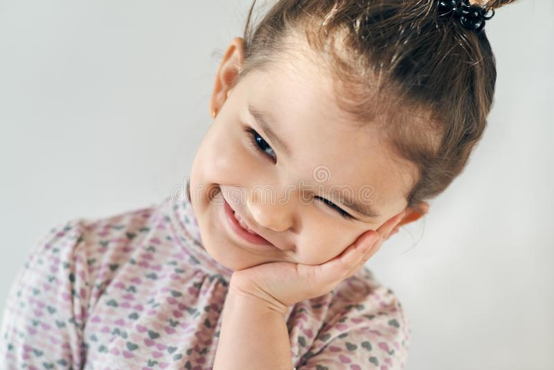 Close-up portrait on a white background happy joyful little girl stock photos