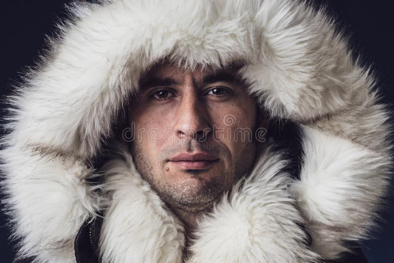 Close up portrait of a white man dressed with an eskimo jacket royalty free stock photo